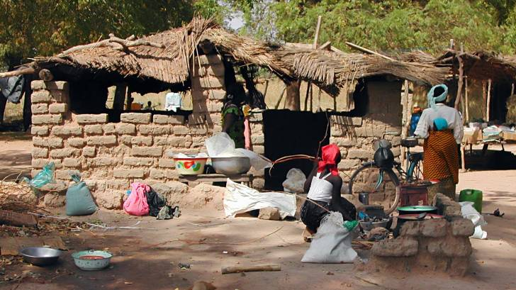 Burkina Faso women and clay homes