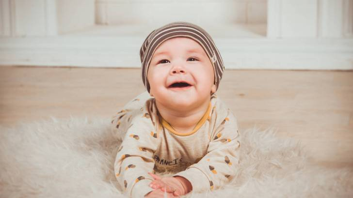 cute baby healthy smiling on the floor
