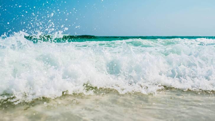 beach ocean surf hitting the beach