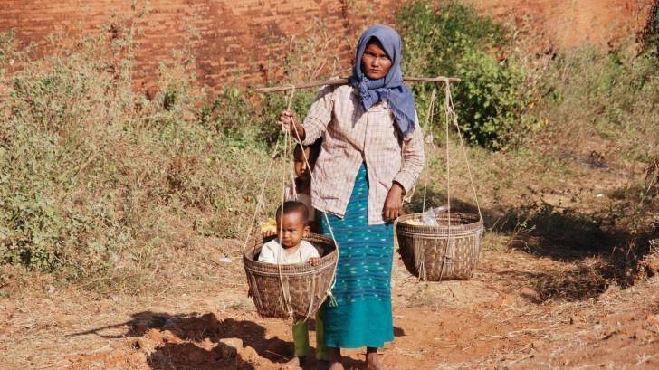 mom and child in a basket in Burma