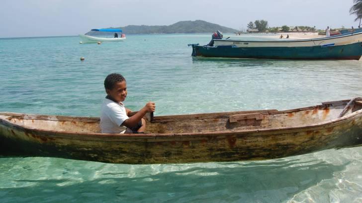 hondurus boy in a canoe