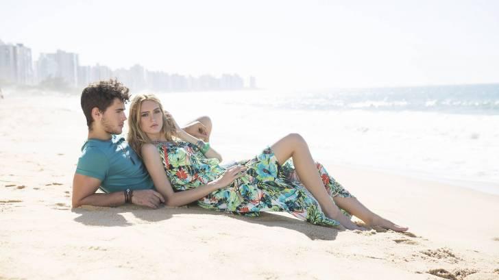 couple laying on brazillan beach