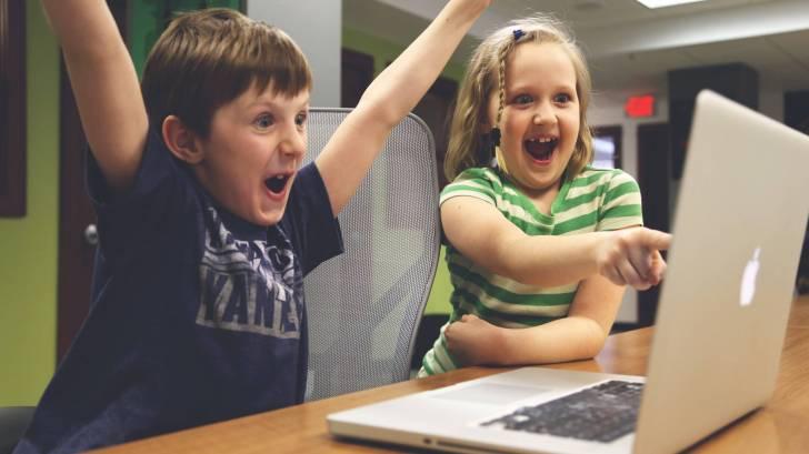 children celebrating on their computer