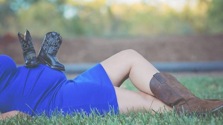 Mom, pregnant with a boy, cowboy boots healthy