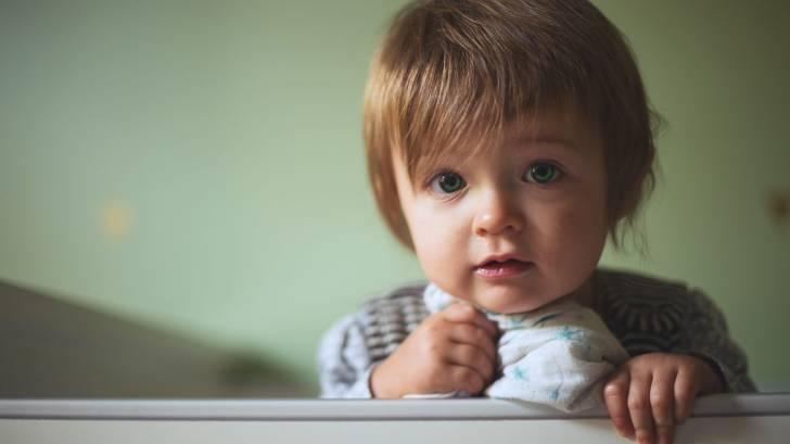 cute toddler in crib