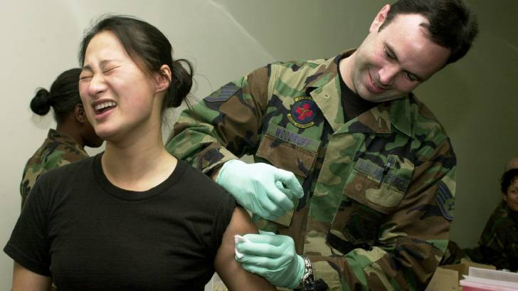 military receiving vaccination