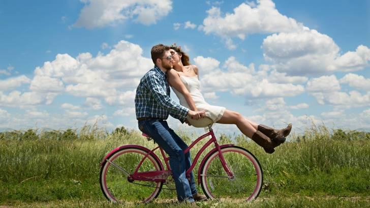couple riding a bike