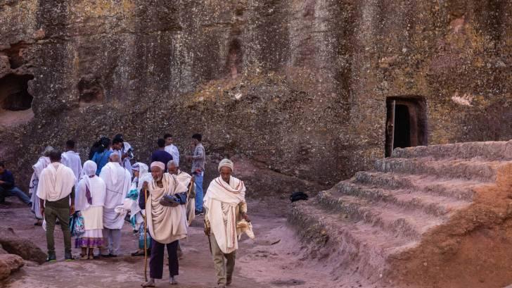 ethiopians outside an ancient building