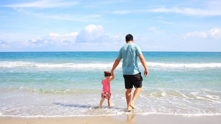 dad and daughter on a Florida beach