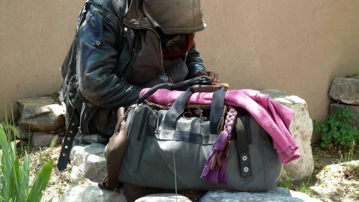 homeless man and his bag