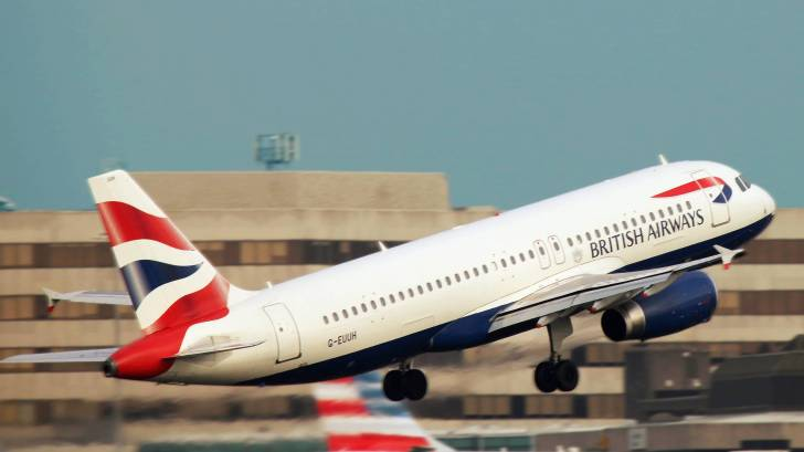 british airlines jet taking off at manchester airport