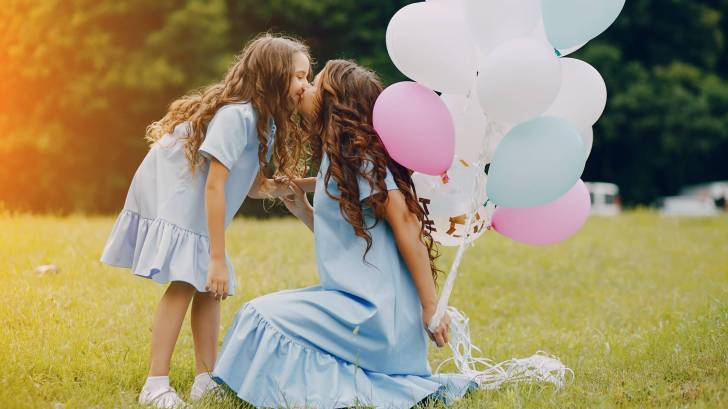 Mom and daughter with balloons