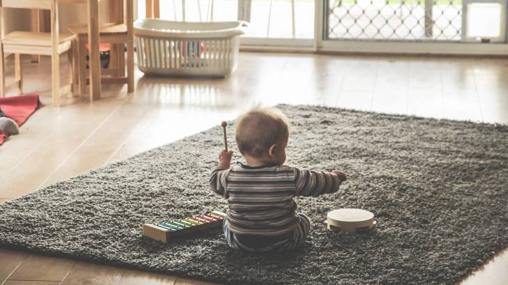 little boy playing the drums
