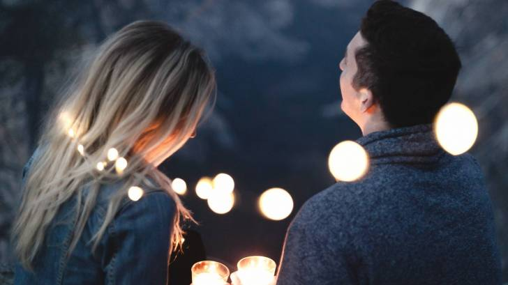 couple in lights at night