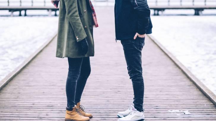 couple on board walk traveling