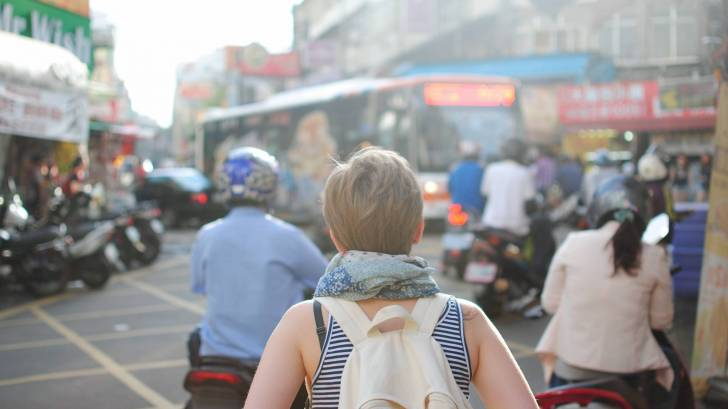 back packer in city traveling across europe