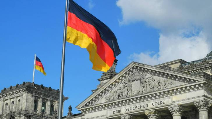 german flag flying over a court building