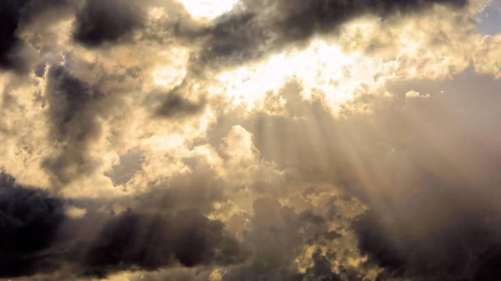 sun spotlighting through clouds