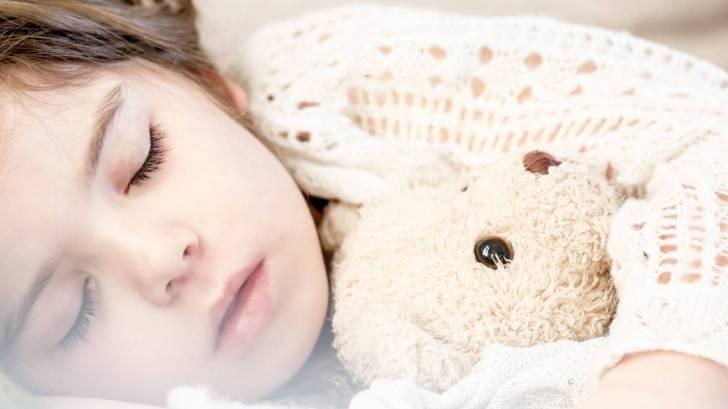 young sleeping little girl with Teddy bear