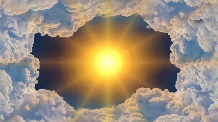hot sun poking thru clouds