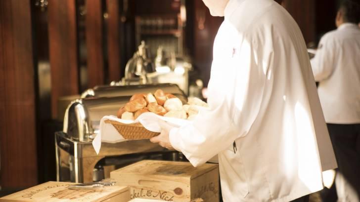waiter serving bread