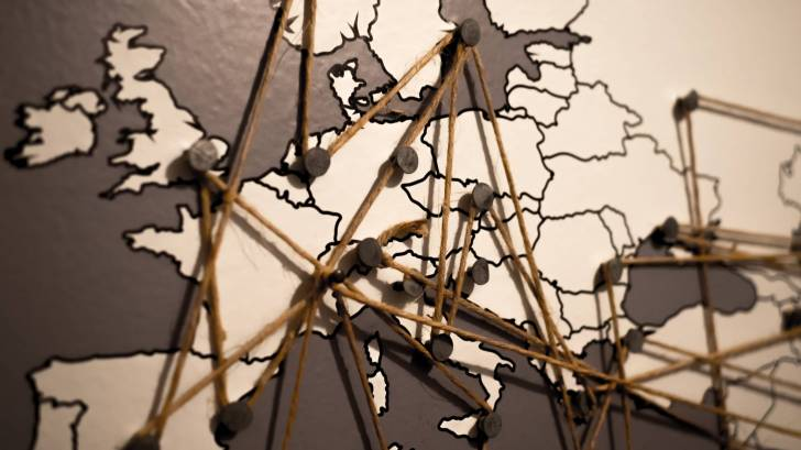 world map showing connection with a string