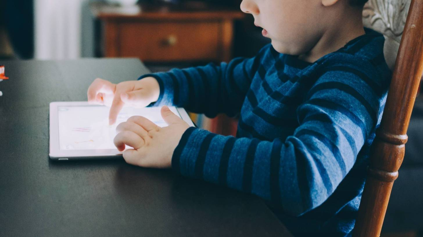young child testing on an ipad