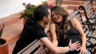 young couple pregnant laughing