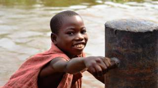 DRC young african boy on the river