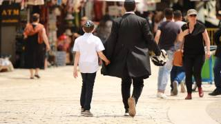 Jewish family walking in Israel