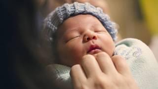 newborn being held by mom