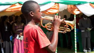 young black boy playing the bugle