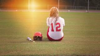 softball player in a field by herself