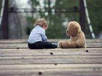 toddler with toy bear